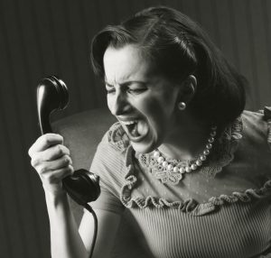 angry cold caller yelling at phone sales
